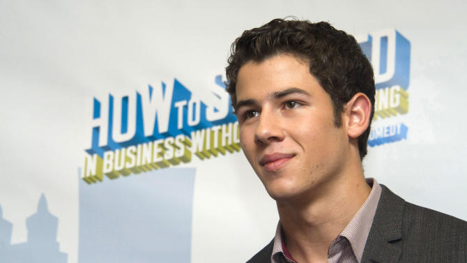"""Nick Jonas attends a news conference to announce he will join the cast of Broadway's """"How to Succeed in Business Without Really Trying"""", in New York, Wednesday, Sept. 7, 2011. (AP Photo/Charles Sykes)"""