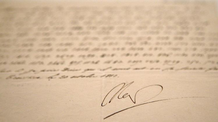 "In this photo taken Wednesday, Nov. 28, 2012, a letter dictated and signed by Napoleon in secret code that declares his intentions ""to blow up the Kremlin"" during his ill-fated Russian campaign is displayed in Fontainebleau, outside Paris. The rare letter, written in unusually emotive language, sees Napoleon complain of harsh conditions and the shortcomings of his grand army. The letter goes on auction Sunday, Dec. 2, 2012. (AP Photo/Christophe Ena)"