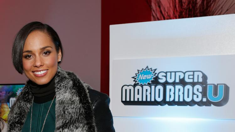 IMAGE DISTRIBUTED FOR NINTENDO - Singer Alicia Keys warms up and checks out Wii U at the Nintendo Lounge during a break from the Sundance Film Festival on Friday, January 18, 2013 in Park City, UT. (Photo by Todd Williamson/Invision for Nintendo/AP Images)
