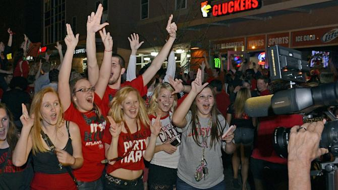 Louisville fans celebrate following their 82-76 victory in the 2013 NCAA Men's National Basketball Championship game Monday, April 8, 2013, in Louisville, Ky. (AP Photo/Timothy D. Easley)