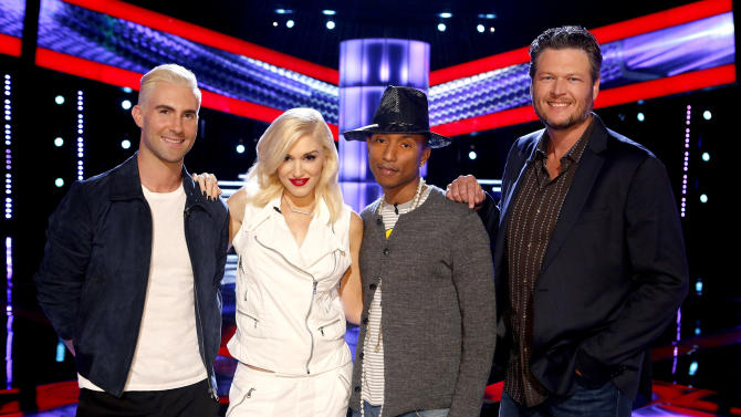 """This May 5, 2014 photo released by NBC shows, from left, Adam Levine, Gwen Stefani, Pharrell Williams, Blake Shelton on the set of """"The Voice,"""" premiering on Sept. 22 . (AP Photo/NBC, Trae Patton)"""