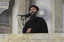 This file image made from video posted on a militant website Saturday, July 5, 2014, which has been authenticated based on its contents and other AP reporting, purports to show the leader of the Islamic State group, Abu Bakr al-Baghdadi, delivering a sermon at a mosque in Iraq. On Sunday, Nov. 9, 2014, Iraqi officials and state television said al-Baghdadi has been wounded in an airstrike in western Iraq. An Interior Ministry intelligence official told The Associated Press on Sunday that the strike happened early Saturday in the town of Qaim in Iraq's Anbar province. (AP Photo/Militant video, File)