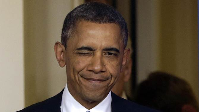 President Barack Obama winks as he arrives to make a statement regarding the passage of the fiscal cliff bill in the Brady Press Briefing Room at the White House in Washington, Tuesday, Jan. 1, 2013. (AP Photo/Charles Dharapak)