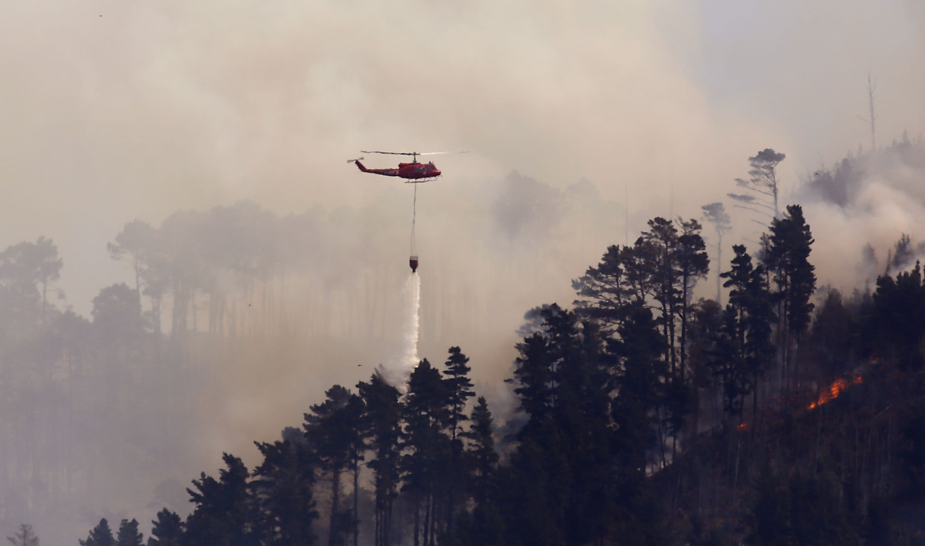 South African firefighters battle wildfire for a third day
