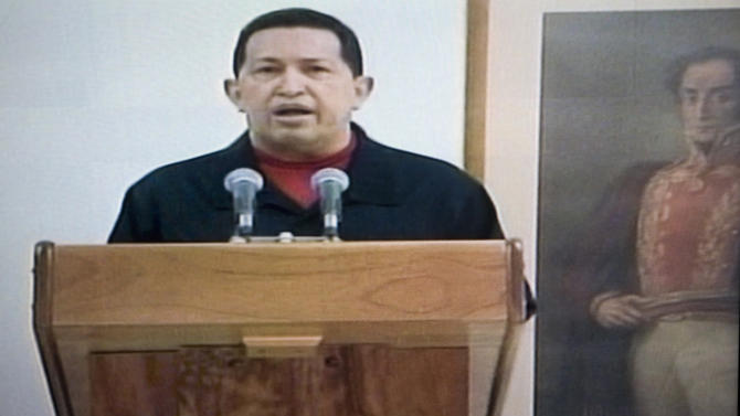 In this frame grab taken from Venezolana de Television, VTV, Venezuela's President Hugo Chavez delivers a televised speech aired from Cuba, Thursday, June 30, 2011. Chavez said he underwent a second surgery in Cuba that removed a cancerous tumor. It was unclear when and where the message was recorded. At right, a painting depicting Venezuela's Independence hero Simon Bolivar. (AP Photo/Ariana Cubillos)