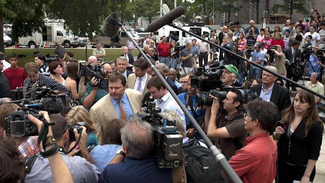Former Major League Baseball pitcher Roger Clemens, center left, leaves a news conference outside federal court with his family in Washington, Monday, June 18, 2012, after Clemens was acquitted on all charges by a jury that decided that he didn't lie to Congress when he denied using performance -enhancing drugs. (AP Photo/Jacquelyn Martin)