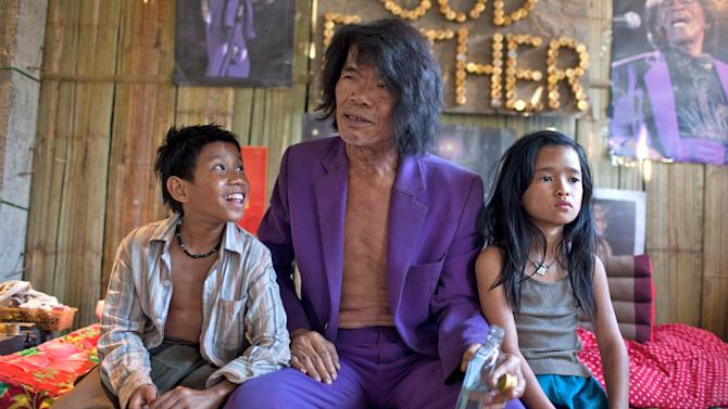 """This undated publicity image released by the TriBeca Film Festival shows Sitthiphon Disamoe as Ahlo, left, Thep Phongam as Purple, and  Loungnam Kaosainam as Kia in a scene from """"The Rocket,"""" a film competing in the Tribeca Film Festival. The Laos adventure """"The Rocket"""" and the Afghanistan War documentary """"The Kill Team"""" have taken top honors at the Tribeca Film Festival on Thursday, April 25, 2013. (AP Photo/Tribeca Film Festival, Tom Greenwood)"""