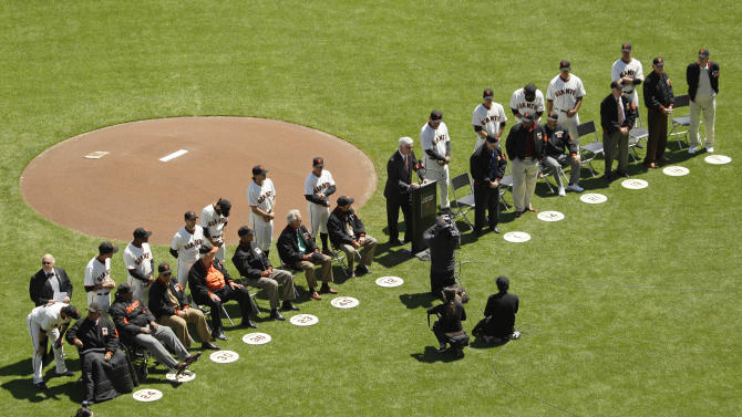 Members of the San Francisco Giants 1962 World Series team are honored before the start of the Giants' Opening Day baseball game against the Pittsburgh Pirates in San Francisco, Friday, April 13, 2012. Giants' Hall-of-Famer Willie Mays is seated at left. (AP Photo/Eric Risberg)