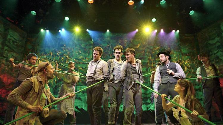 "In this theater image released by The O & M Co., David Rossmer,  center left, Adam Chanler-Berat, center, and Carson Elrod, center right, and the cast are shown in a scene from ""Peter and the Starcatcher,"" performing at the brooks Atkinson Theatre in New York. (AP Photo/The O & M Co.)"