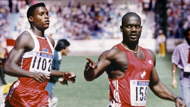 Ben Johnson of Canada (R) celebrates in front of Carl Lewis of the US (L) after winning the men's 100 metres final at the 1988 Seoul Olympics