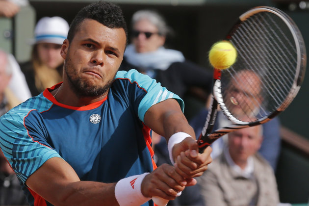 Jo-Wilfried Tsonga of France returns in his fourth round match against Stanislas Wawrinka of Switzerland at the French Open tennis tournament in Roland Garros stadium in Paris, Sunday June 3, 2012. (A