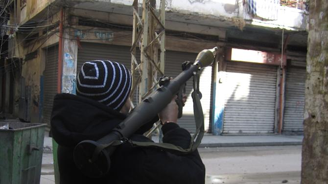 A man holds a rocket-propelled grenade launcher during clashes in Tripoli, Lebanon, Saturday, Feb. 11, 2012. Lebanese security officials say clashes between pro- and anti-Syria gunmen in a northern Lebanese city have left one person dead and several wounded. The officials say the two sides fired on each other from two rival neighborhoods in Tripoli, one dominated by Sunnis, the other by Alawites, a Shiite offshoot sect. They say clashes started Friday night and continued sporadically until Saturday. (AP Photo)