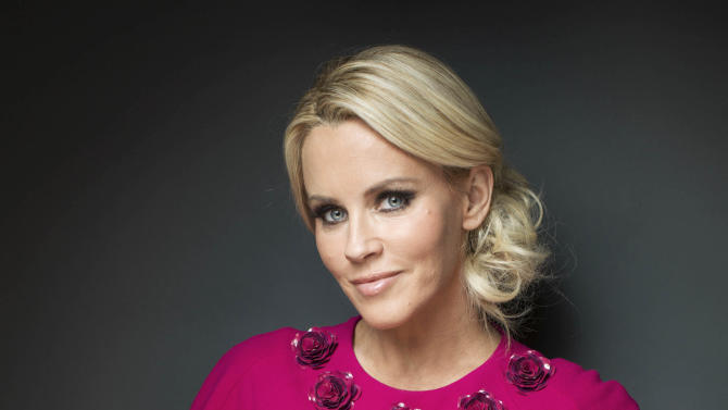 """FILE - This Feb. 4, 2013 file photo shows American comedian, actress, and author Jenny McCarthy posing for a portrait, in New York. The actress and former Playboy playmate was named Monday, July 15, to join the panel of the ABC weekday talk show """"The View."""" Barbara Walters, who created """"The View"""" in 1997 and has since served as a co-host, made the widely expected announcement on the air. (Photo by Victoria Will/Invision/AP, File)"""