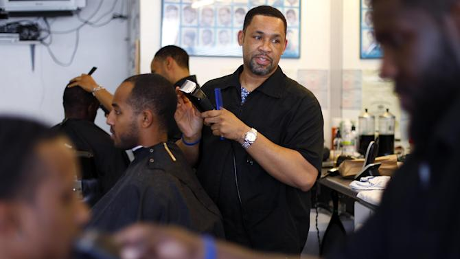 "Dorsey Jackson cuts hair at his establishment Jackson's Barbershop, Friday, May 11, 2012, in Ardmore, Pa. Like many black Americans, Dorsey Jackson does not believe in gay marriage, but he wasn't disillusioned when Barack Obama became the first president to support it. The windows of his suburban Philadelphia barbershop still display an ""Obama 2012"" placard and another that reads ""We've Got His Back.""(AP Photo/Matt Rourke)"