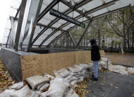FILE - This Oct. 30, 2012 file photo shows man peering into the closed Bowling Green subway station in New York, after Superstorm Sandy his the east Coast. Extreme weather is a growing threat to the nation's lifelines _ its roads, bridges, railways, airports and transit systems _ leaving states and cities trying to come to terms with a new normal. (AP Photo/Richard Drew, File)