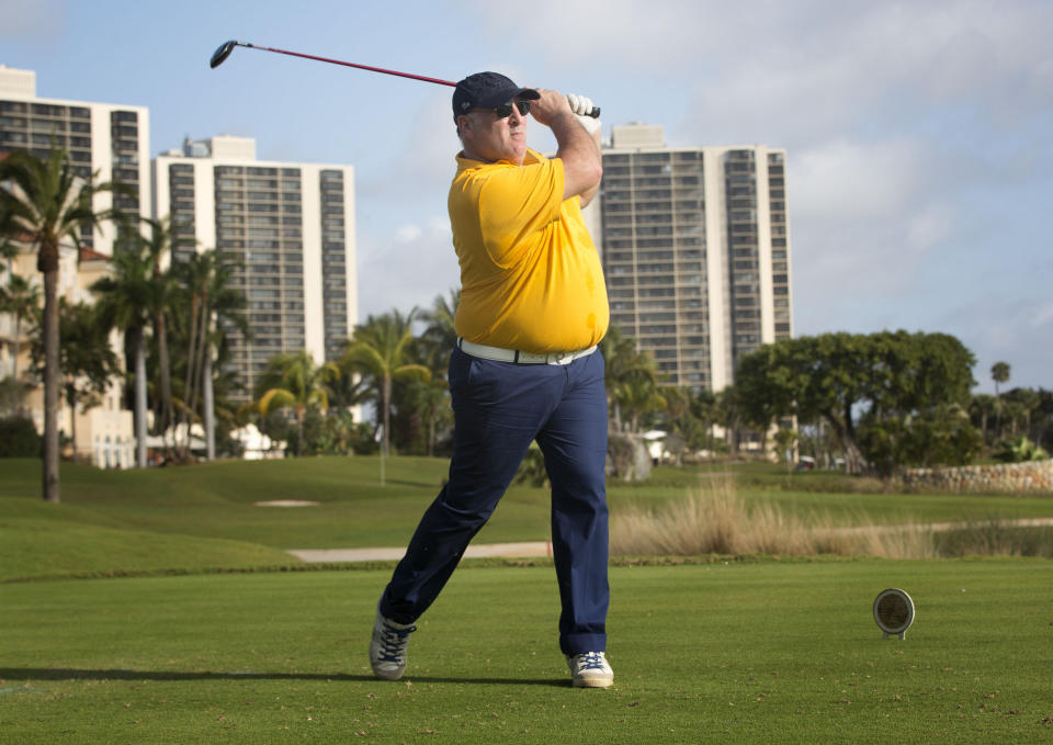Chef Jose Andres tees-off during a Miami Beach, Fla. golf tournament Saturday, Feb. 23, 2013.  Nearly a dozen A-list chefs took to the links early Saturday during the South Beach Wine and Food Festival for a battle of the chefs during a golf tournament. (AP Photo/J Pat Carter)