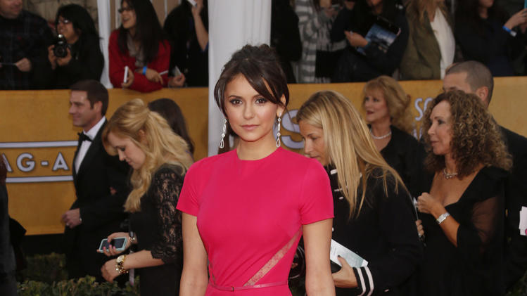 Nina Dobrev arrives at the 19th Annual Screen Actors Guild Awards at the Shrine Auditorium in Los Angeles on Sunday Jan. 27, 2013. (Photo by Todd Williamson/Invision for The Hollywood Reporter/AP Images)