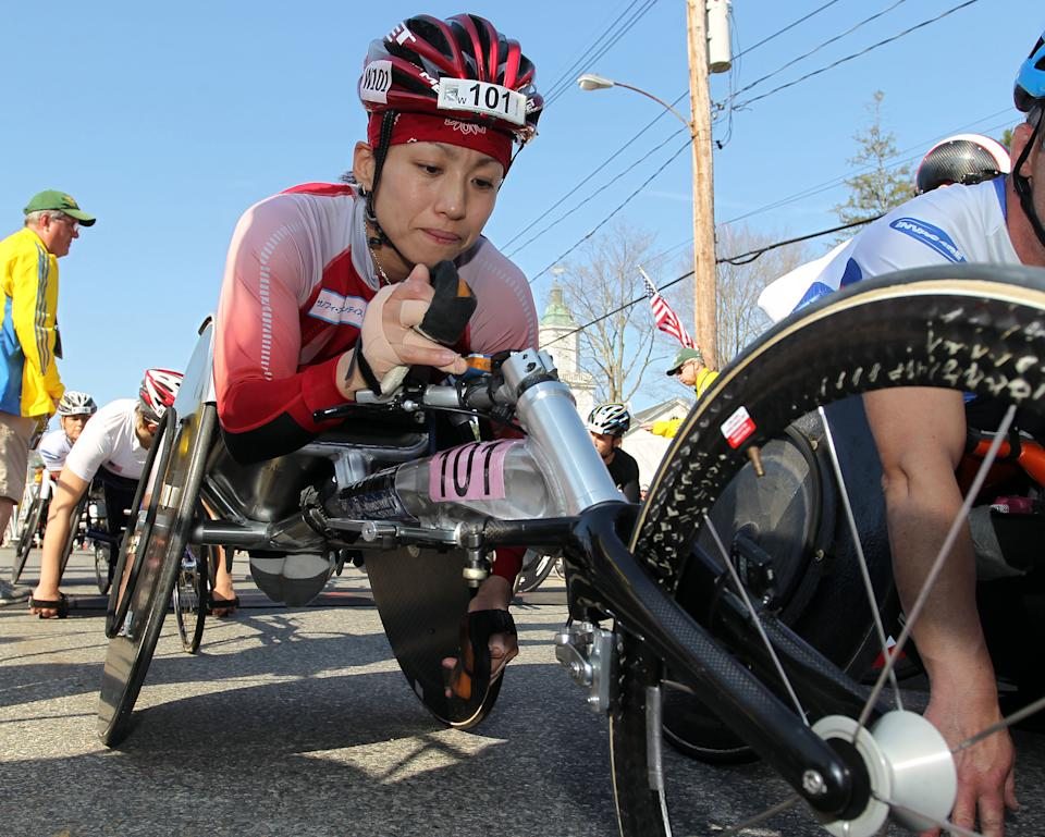 Wakako Tsuchida, center, from Japan, waits for the start of the wheelchair division of the 116th running of the Boston Marathon, in Hopkinton, Mass., Monday, April 16, 2012. (AP Photo/Stew Milne)