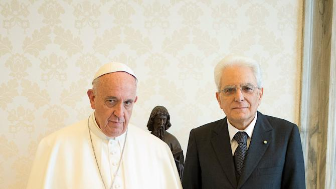 Pope Francis poses with Italy's President Sergio Mattarella during a private audience in the pontiff's studio at the Vatican