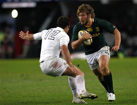 South Africa's Steyn attempts to break past England's Barritt during their first rugby test match in Durban