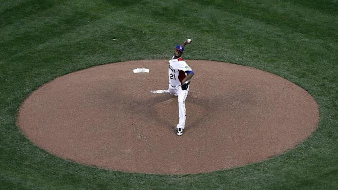 The Dominican Republic's Samuel Deduno pitches against Puerto Rico during the first inning of the championship game of the World Baseball Classic in San Francisco, Tuesday, March 19, 2013. (AP Photo/Jeff Chiu)