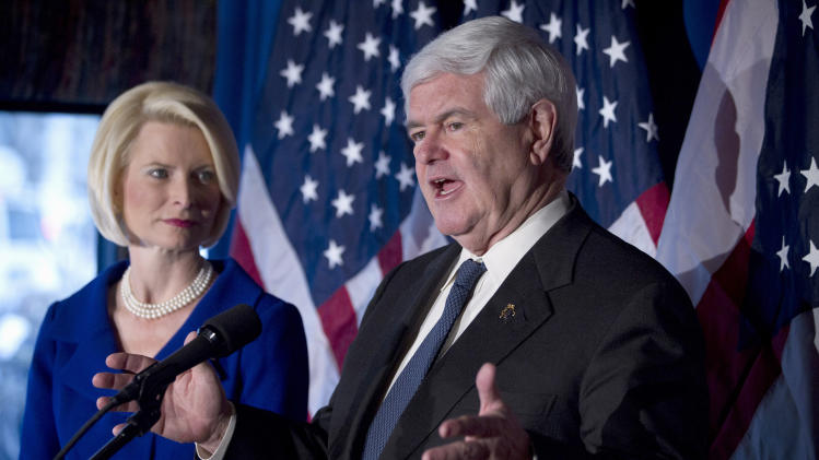 FILE - In this Feb. 7, 2012 file photo, Republican presidential candidate, former House Speaker Newt Gingrich, accompanied by his wife Callista, speaks in Cincinnati, Ohio. Presidential campaigns and outside political groups began filing detailed financial reports Monday, offering a behind-the-scenes glimpse into the identities of wealthy supporters who will help elect the next president and details on how tens of millions of campaign dollars have been spent.  (AP Photo/Evan Vucci, File)
