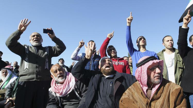Syrian protesters living in Jordan and supporters of Islamic Front Action party shout slogans during demonstration at event marking thousandth day of the Syrian civil war, in front of Syrian embassy in Amman