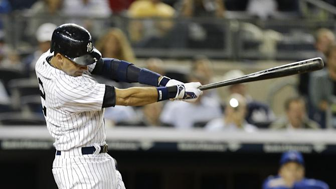 New York Yankees' Derek Jeter follows through on a home run during the sixth inning of a baseball game against the Toronto Blue Jays Thursday, Sept. 18, 2014, in New York. (AP Photo/Frank Franklin II)