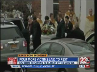 Four more laid to rest
