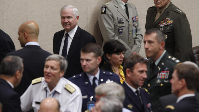 U.S. Secretary of Defense Robert Gates, top,   arrives at a meeting with NATO and non-NATO ISAF participating nations at the NATO Defence Ministers Summit in Brussels, Thursday June 9, 2011.   (AP Photo/Jason Reed, Pool)