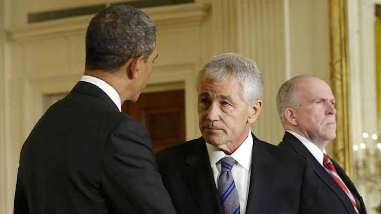 President Barack Obama shakes hands with choice for Defense Secretary, former Nebraska Sen. Chuck Hagel, center, after announcing Hagel's nomination, Monday, Jan. 7, 2013, in the East Room of the White House in Washington. Obama also announced that he is nominating Deputy National Security Adviser for Homeland Security and Counterterrorism, John Brennan, right, as the new CIA director. (AP Photo/Pablo Martinez Monsivais)