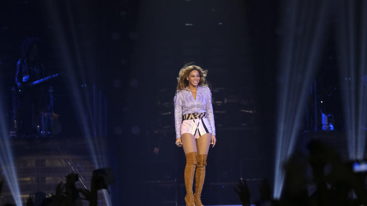 "Singer Beyonce performs on her ""Mrs. Carter Show World Tour 2013"", on Friday, April 19, 2013 at the Slovnaft Arena in Bratislava, Slovakia. Beyonce is wearing a lilac hand beaded jacket and boots by Pucci. (Photo by Yosra El-Essawy/Invision for Parkwood Entertainment/AP Images."
