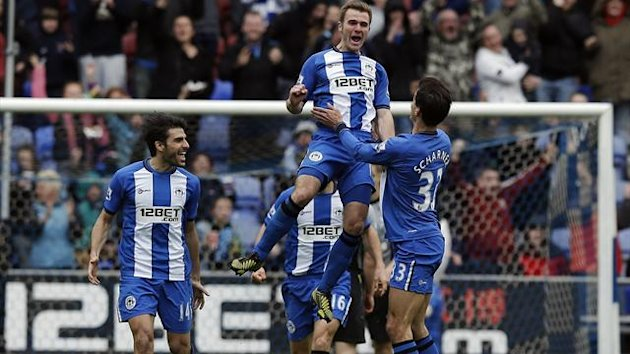 2013Wigan Athletic's Callum McManaman (top) celebrates after scoring his side's second goal during their English Premier League soccer match against Tottenham Hotspur at The DW Stadium in Wigan, northern England, April 27, 2013