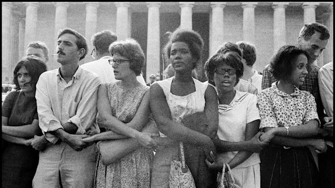 """This August 28, 1963 publicity photo provided by PBS, courtesy Leonard Freed/Magnum Photos, shows activists during The March on Washington in Washington, D.C. from the film,""""Makers: Women Who Make America."""" The Women's Movement was influenced in part by the Civil Rights Movement. The three-hour PBS documentary about the fight for women's equality, airs Tuesday, Feb. 26, 2013, and features prominent activists including Gloria Steinem and Marlo Thomas. (AP Photo/PBS, Courtesy Leonard Freed, Magnum Photos)"""