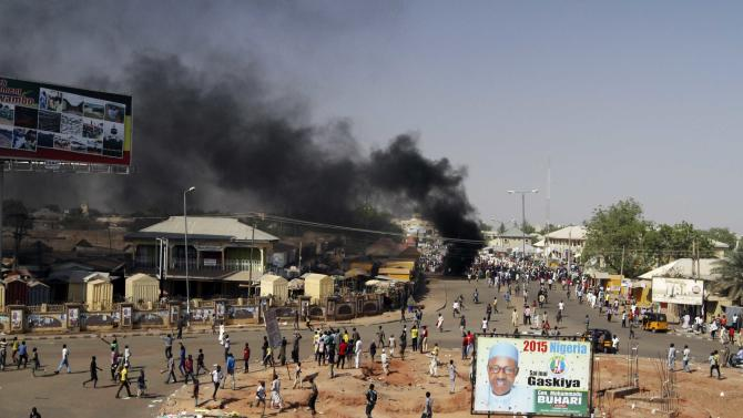 Smoke is seen after an suicide bomb explosion in Gombe, a day ahead of Nigeria's President Goodluck Jonathan's visit to the state for an election campaign rally