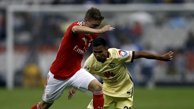 Nuno Santos of Benfica controls the ball past Carlos Rosel of Mexico's America during their International Champions Cup Pre Season Friendly Tournament