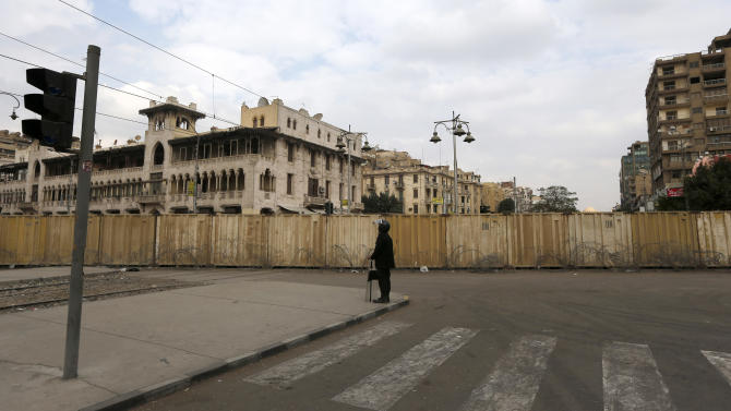 A soldier stands guard in front of the presidential palace in Cairo, Egypt, Friday, Dec. 14, 2012. Opposing sides in Egypt's political crisis were staging rival rallies on Friday, the final day before voting starts on a contentious draft constitution that has plunged the country into turmoil and deeply divided the nation. (AP Photo/Petr David Josek)