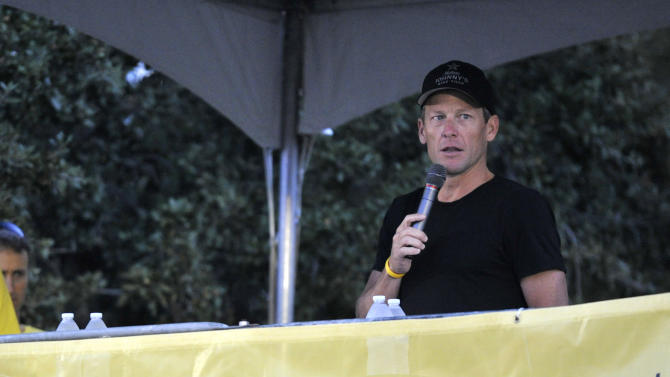 Lance Armstrong speaks at the Livestrong Challenge Austin bike ride Sunday, Oct. 21, 2012, in Austin, Texas. Lance Armstrong greeted about 4,300 cyclists at his Livestrong charity's fund-raising bike ride, then retreated into privacy as cycling officials get set to announce if they will appeal his lifetime ban and loss of seven Tour de France titles ordered by the U.S. Anti-Doping Agency. (AP Photo/Michael Thomas)
