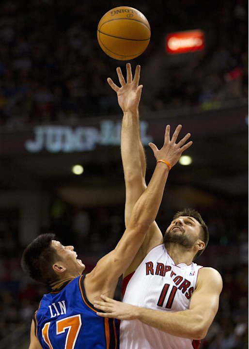 New York Knicks guard Jeremy Lin (17) is beaten on a jump ball by Toronto Raptors forward Linas Kleiza during the first half of an NBA basketball game in Toronto on Tuesday, Feb. 14, 2012. (AP Photo/T