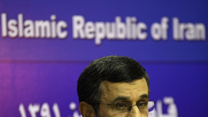 "Iran's President Mahmoud Ahmadinejad listens to media questions during a press conference in Cairo, Egypt, Thursday, Feb. 7, 2013. Iranian President Mahmoud Ahmadenijad is trying to entice Egypt into a new and powerful axis that could reshape the turbulent Middle East, speaking of forging ""comprehensive"" and ""unfettered"" relations after decades of distrust. A warming of ties could have uncomfortable repercussions for the U.S. and its wealthy Gulf allies, giving Iran a foothold to spread its influence in Egypt. In turn, Egypt could gain an avenue to influence the fate of Syria, a key ally of Iran, as well as economic benefits. (AP Photo/Khalil Hamra)"
