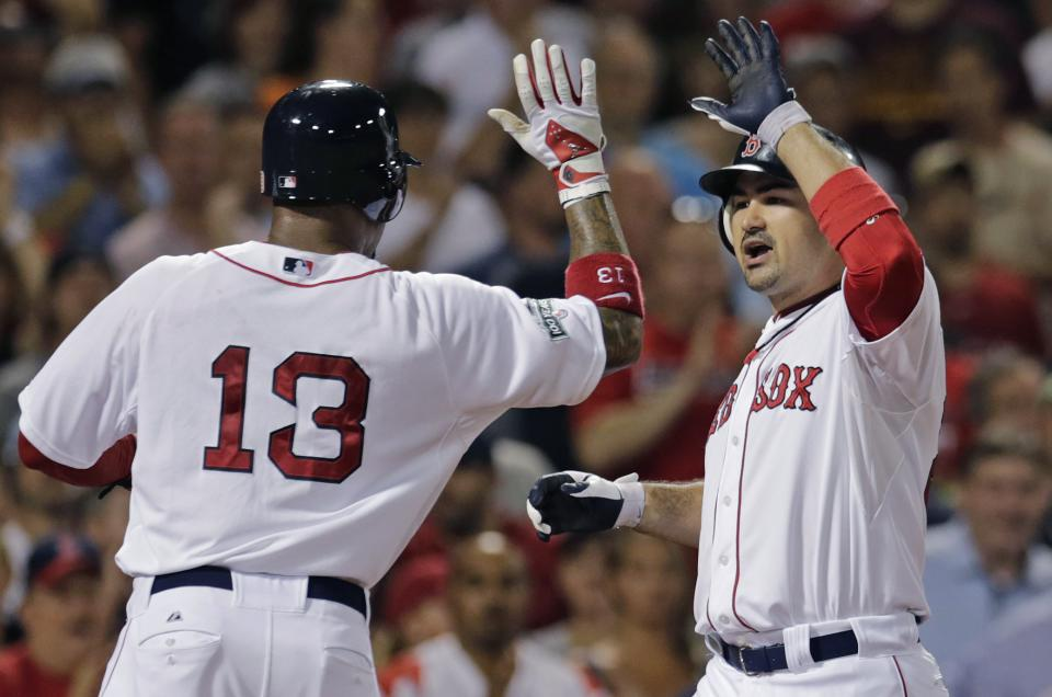 Boston Red Sox's Adrian Gonzalez, right, is congratulated by Carl Crawford on his three-run home run in the eighth inning of a baseball game against the Chicago White Sox at Fenway Park in Boston, Monday, July 16, 2012. (AP Photo/Charles Krupa)