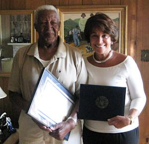 This 2009 photo provided by the office of U.S. Rep. Anna Eshoo, D-Palo Alto, shows Menlo Park resident Carl Clark, left, given a proclamation and a flag flown over the U.S. Capitol by U.S. Rep. Anna Eshoo, D-Palo Alto. It was announced Dec. 22, 2011 that Clark will be formally presented in January 2012 with the Navy and Marine Corps Commendation Medal with the Combat Distinguished Device for his service during World War II.  (AP Photo/Office of U.S. Rep. Anna Eshoo)