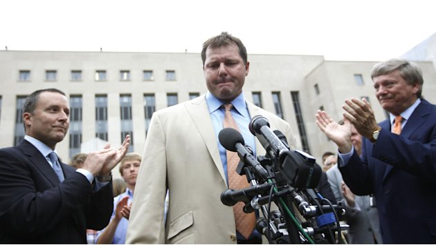 Former Major League Baseball pitcher Roger Clemens, center, is applauded by his attorney's, Rusty Hardin, right, and Michael Attanasio, left, outside federal court in Washington, Monday, June 18, 2012