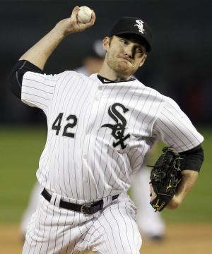 Chicago White Sox starting pitcher Philip Humber throws during the first inning of a baseball game against the Los Angeles Angels in Chicago, Friday, April 15, 2011. (AP Photo/Nam Y. Huh)