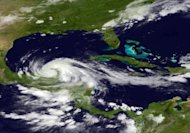 This NASA satellite image shows Tropical Storm Ernesto over Mexico's Yucatan peninsula in the Caribbean Sea. Ernesto weakened to a tropical storm as it swept over Mexico's Yucatan peninsula early Wednesday, but forecasters predicted it could soon regain strength
