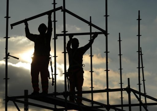 "<p>Two men build scaffolding during construction work near the small Bavarian village Germering near Munich, southern Germany, in November 2011. Germany's leading economic think tanks warned on Thursday there was a ""great danger"" that Europe's top economy could fall into recession, as they slashed their growth forecasts for next year in half.</p>"