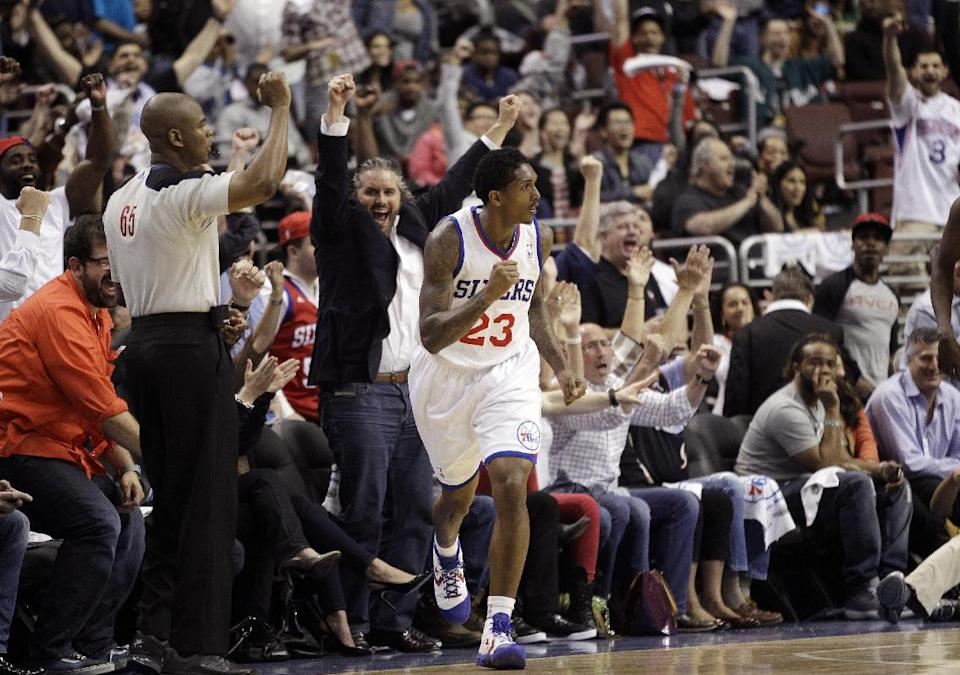 Philadelphia 76ers' Lou Williams (23) reacts with fans after making a three-point basket in the first half of Game 6 in an NBA basketball first-round playoff series against the Chicago Bulls, Thursday, May 10, 2012, in Philadelphia. (AP Photo/Matt Slocum)