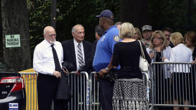 """Actor Dominic Chianese, left, arrives at the the Cathedral Church of Saint John the Divine ahead of the funeral service for James Gandolfini, Thursday, June 27, 2013 in New York. Gandolfini, who played Tony Soprano in the HBO show """"The Sopranos"""", died while vacationing in Italy last week. (AP Photo/Mary Altaffer)"""