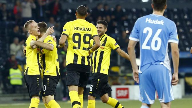 BSC Young Boys' Adrian Nikci celebrates scoring a goal with team mates during their Europa League group I soccer match against Slovan Bratislava in Bern