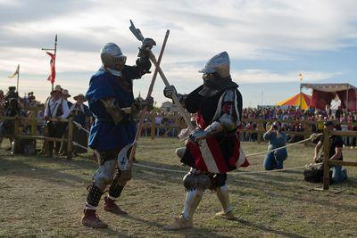 Watch dudes in suits of armor battle with swords in the Medieval Combat World Championship